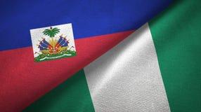Haiti- und Nigeria-zwei Flaggentextilstoff, Gewebebeschaffenheit stockfotografie