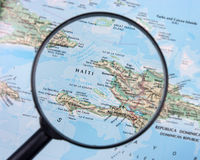 Haiti under magnifier Royalty Free Stock Photos