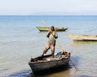 Haitian Fisherman Launching his Boat Royalty Free Stock Photography