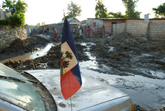 Haitian Flag. September 26, 2008 - A Haitian flag hangs from a car in Gonaives, Haiti, destroyed by flooding in the wake of Hurricane Ike and Tropical Storm Royalty Free Stock Photography