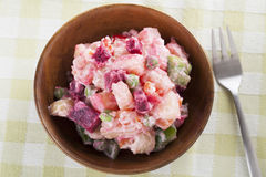 Haitian Potato Salad. In wooden bowl with fork royalty free stock image