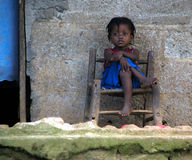 Haitian Young Girl on Porch Royalty Free Stock Photos
