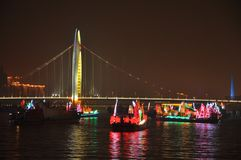 Haiyin Bridge over the Pearl River in Guangzhou Canton China. Night View of the Haiyin Bridge and dragon boat over the Pearl River in Guangzhou China stock images