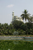 Haj House, Hyderabad, India. View across the lush Public Gardens in the centre of Hyderabad, India with the landmark Haj House in the distance Royalty Free Stock Image