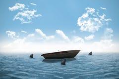 Hajar som cirklar det lilla fartyget i havet Royaltyfria Bilder