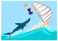 Hajen förföljer vindsurfaren Arkivbilder