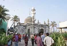 Haji Ali Mosque in Mumbai, India. Devotees and tourists on their way to Haji Ali Mosque located in Mumbai, India Royalty Free Stock Photos