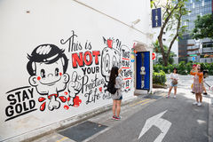 Haji Lane is the Kampong Glam, Singapore. SINGAPORE - CIRCA FEBRUARY, 2015: Graffiti on the walls of old buildings Haji Lane. Haji Lane is the Kampong Glam (Arab Royalty Free Stock Photo