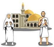 Hajj pilgrim praying in front of mosque Stock Images