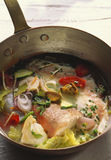 Hake. Pot-au-feu of hake and gurnard in pan Royalty Free Stock Images
