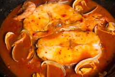 Hake in cider sauce Stock Photo