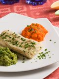 Hake filet. With carrots and broccolis purees in an elegant dinner plate Stock Images
