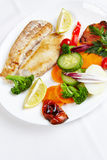 Hake filet with grilled vegetables Royalty Free Stock Images
