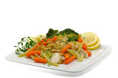 Hake fillet. Steamed with vegetables and thyme Stock Image
