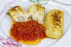 Hake fillet with fresh tomato sauce Stock Photos