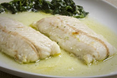 Hake fillets. With spinach in a plate Stock Photography