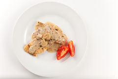 Hake fillets with cheese sauce and mushrooms Royalty Free Stock Images