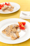 Hake fillets with cheese sauce and mushrooms Stock Photos