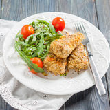 Hake fish coated in oatmeal Stock Photography