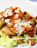 Hake fish on salad Royalty Free Stock Photography