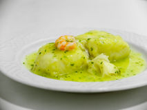 Hake in green sauce. Stock Photo