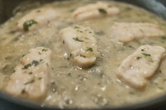 Hake in green sauce Stock Photography