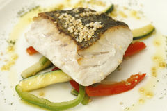 Hake roasted with vegetables Stock Photo