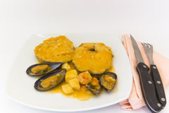 Hake sauce. Hake mussels in sauce with cuttlefish and prawns Stock Photos