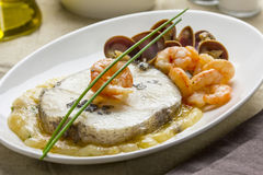 Hake with shrimps and clams Stock Images
