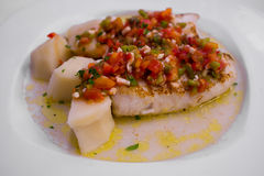 Hake steak with pepper vinaigrette Stock Photography