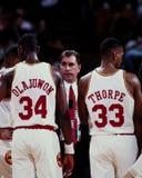Hakeem Olajuwon, Rudy Tomjanovich and Otis Thorpe, Houston Rockets. Houston Rockets Otis Thorpe (33) and Hakeem Olajuwon (34) go into huddle with head coach Stock Photography