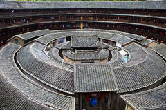 Hakka Roundhouse tulou walled village, Fujian, Chi. Hakka Roundhouse tulou walled village located in Fujian, China Stock Photos