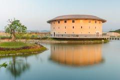 Hakka Tulou structures in Miaoli, Taiwan. Hakka Tulou structures by the pond Royalty Free Stock Photo