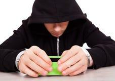 Hakker met een Kaart Stock Afbeelding