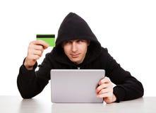 Hakker met een Tablet Stock Foto