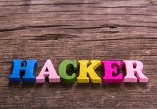 Hakkerwoord van houten brieven wordt gemaakt die royalty-vrije stock foto