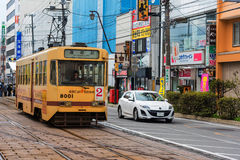 Hakodate city Tram. HAKODATE, HOKKAIDO - APRIL 22, 2016: Yellow Hakodate city Tram on railway. This tram can bring passengers to all city travel destinations Royalty Free Stock Image