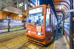 Hakodate, Japan Tram. HAKODATE, JAPAN - OCTOBER 25, 2012: Passengers alights from the tram. The tram originates from 1897 and is a local landmark as well as an Stock Images