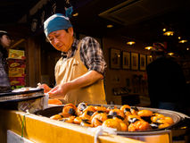 HAKONE, JAPAN - JULY 02, 2017: Unidentified Japanese man cooking food at street, based on mobile food stands where Royalty Free Stock Photos