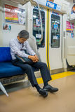 HAKONE, JAPAN - JULY 02, 2017: Unidentified man sleeping at the interior of train during rainy and cloudy day. Hakone,Japan-September 14th,2016. Interior of Stock Photo