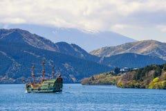 Pirate sightseeing ship at Ashi lake, Hakone. Hakone, Japan - May 4, 2017: Unidentified people on green pirate tourist ship tour on Ashi lake with mountain Fuji Royalty Free Stock Photography