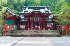 Hakone Shinto Shrine with devotees offering pray. Hakone, Japan - September 3, 2016: Hakone Shrine with devotees offering pray. Hakone Shrine, Hakone Gongen is a royalty free stock photos