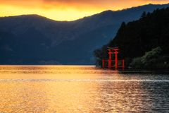 Hakone Torii gate at Lake Ashi during sunset. Red Torii gate at Lake Ashi during sunset in Hakone, Japan. Natural silhouette landscape with sunset relfection on stock image