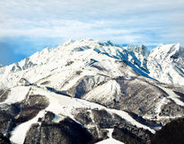Hakuba mountain range in afternoon early winter. Hakuba mountain range in the afternoon early winter.  The gondola and chair lifts visible are located on the top Royalty Free Stock Image
