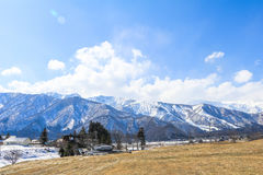 Hakuba mountain range  and  Hakuba village houses  in the winter. With snow on the mountain and blue sky and clouds background in Hakuba  Nagano Japan Stock Images