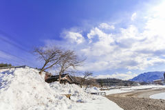 Hakuba mountain range  and Lake in the winter with snow on the m. Ountain and blue sky and clouds background in Hakuba  Nagano Japan Stock Image