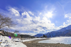 Hakuba mountain range  and Lake in the winter with snow on the m. Ountain and blue sky and clouds background in Hakuba  Nagano Japan Stock Photos