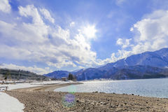 Hakuba mountain range  and Lake in the winter with snow on the m. Ountain and blue sky and clouds background in Hakuba  Nagano Japan Royalty Free Stock Photography