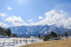 Hakuba mountain range    in the winter with snow on the mountain. And blue sky and clouds background in Hakuba  Nagano Japan Royalty Free Stock Images