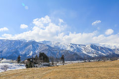 Hakuba mountain range    in the winter with snow on the mountain. Hakuba mountain range   in the winter with snow on the mountain and blue sky and clouds Stock Images